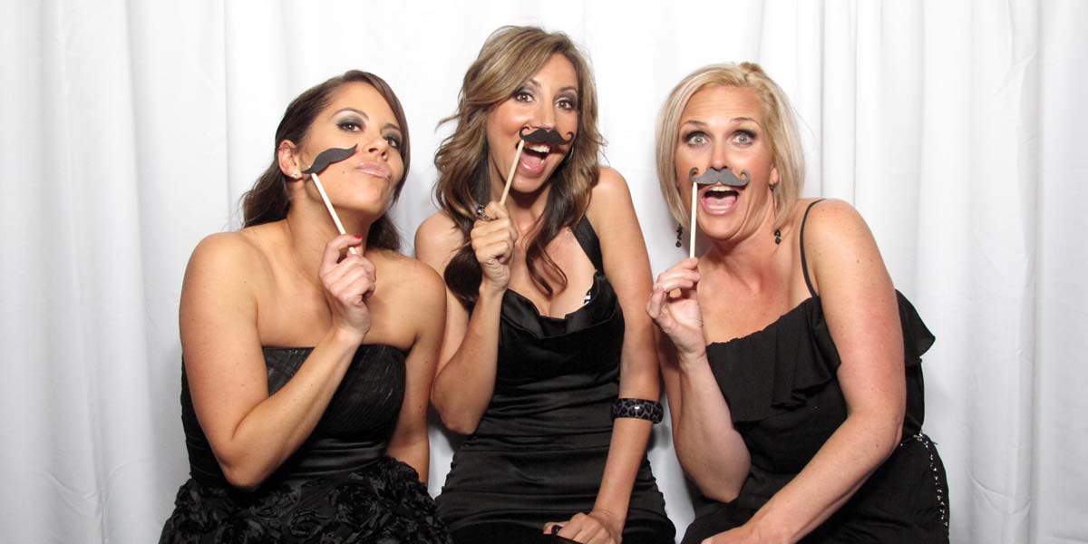 Sit N Grin Photo Booth picture of 3 women with props at a Charity Event